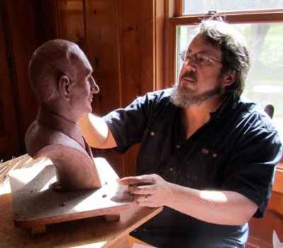 David, working on a portrait bust.