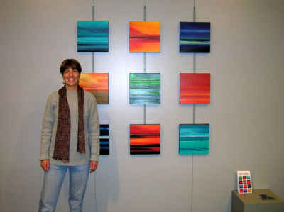 Paula Schoen with her paintings.